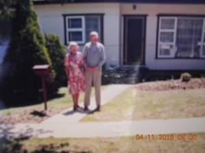 My parents in front of 'own' home in Revesby.