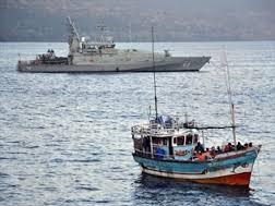 Tow back boats by Australian Navy