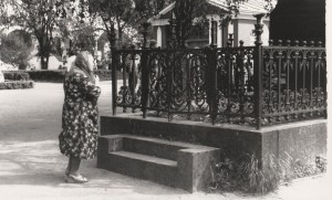 A Babushka paying respect to a noble forefather, probably a Tolstoy.