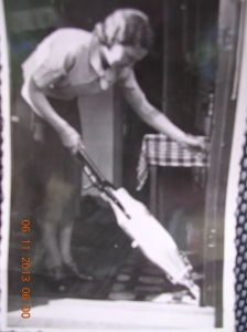 Mum in Holland with a Hoover electric vacuum cleaner. (not cordless)