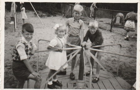 photo taken within a few months of landing 1956. Sister Dora and brothers Herman and Adrian in the middle of merry go round.