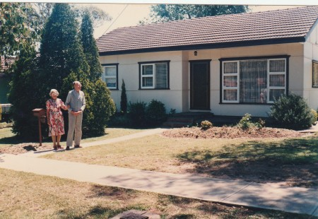 My parents in front of their old house. It was their last visit to Australia.