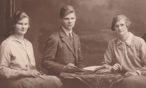 mother on left. her brother and sister.