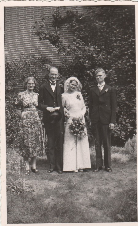 wedding photo of my parents with mum's brother and sister.